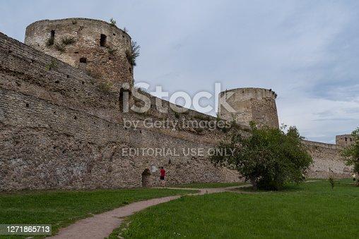 Ryabinovka Tower and Vyshka Tower with wall in medieval Izborsk fortress. Izborsk, Pskov region, Russia.