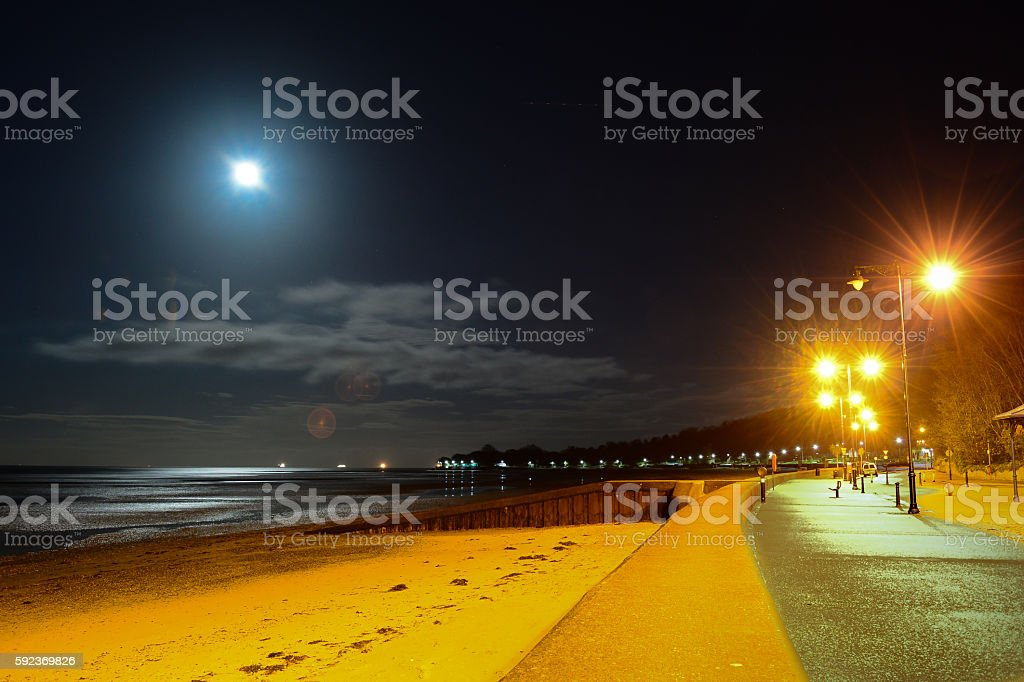 Ryde Beach and Full Moon - Isle of Wight stock photo