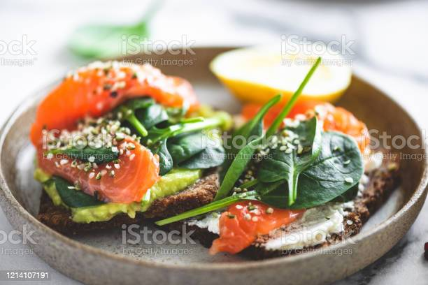 Rye Bread Toast With Avocado Salmon Cream Cheese Stock Photo - Download Image Now