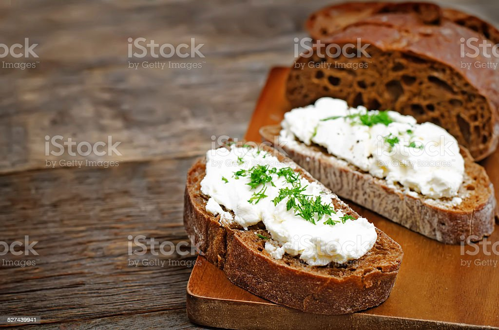 rye bread with cream cheese and dill stock photo