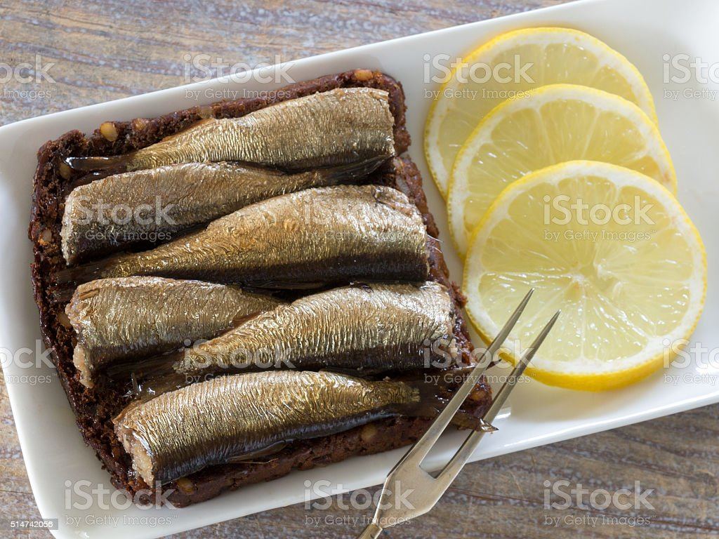 Rye bread with sprats and lemon royalty-free stock photo
