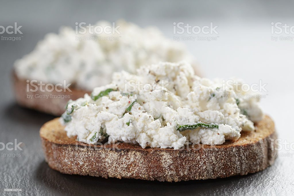 rye sandwiches or bruschetta with ricotta cheese and herbs stock photo