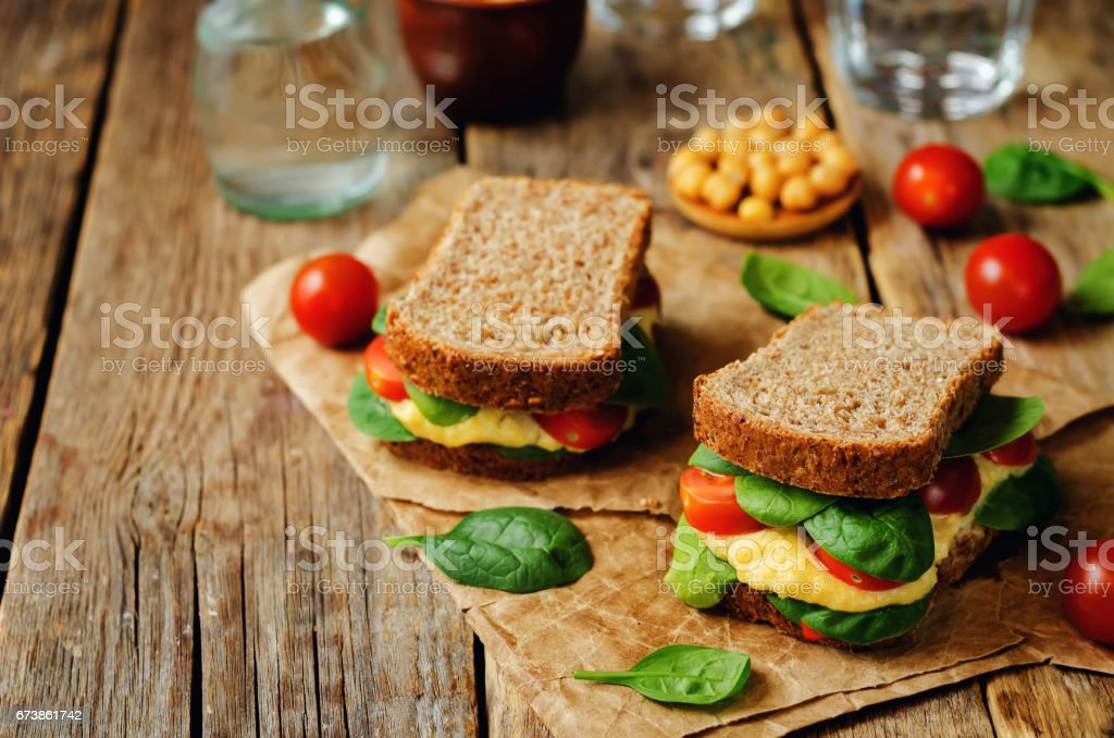 rye sandwiches with hummus, spinch and tomatoes royalty-free stock photo