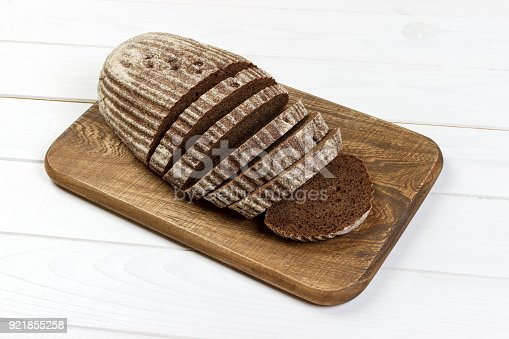 istock Rye sliced bread on the white table 921855258