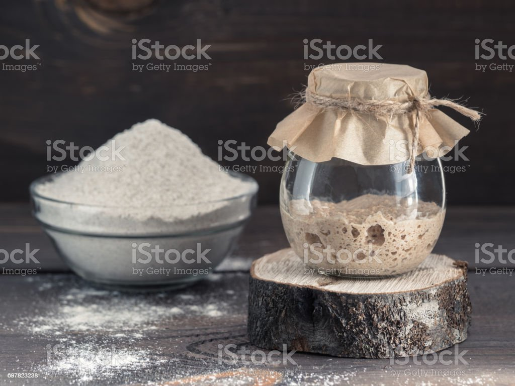 rye sourdough starter and rye flour stock photo
