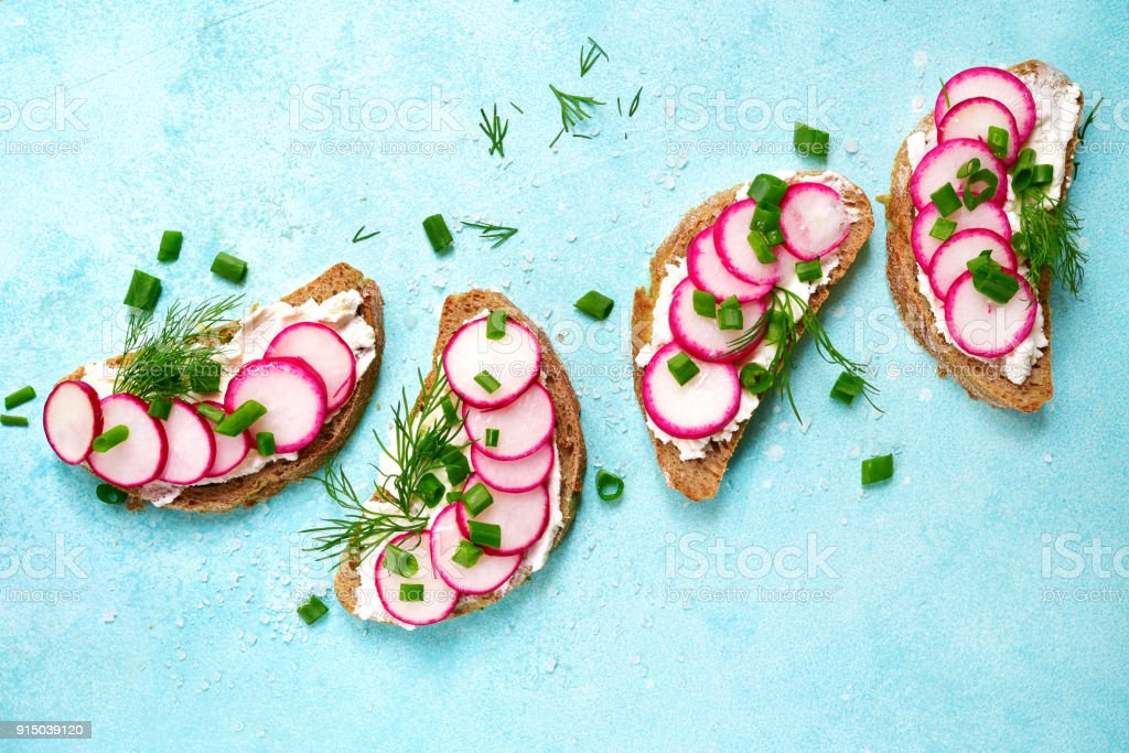 Rye toasts with soft cheese, redish and dill stock photo