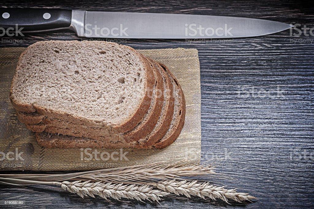 Rye wheat ears carving board sliced bread kitchen knife food stock photo