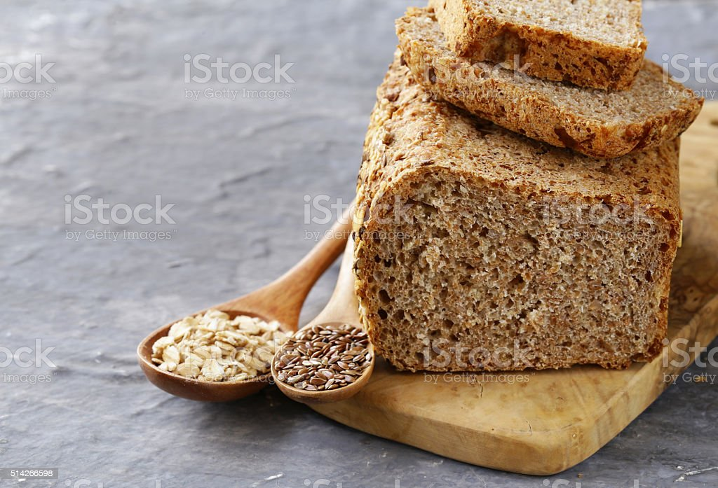 rye wholemeal bread with flax seed and oatmeal stock photo