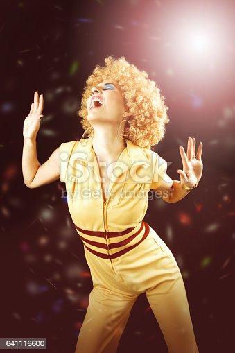 A woman having a great time disco dancing.