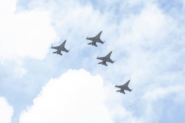 f16's flyover south florida to salute the american heroes - memorial day weekend stock pictures, royalty-free photos & images