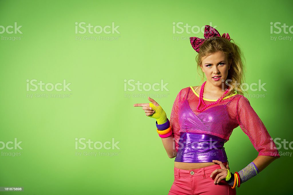 1980's girl pointing at copyspace stock photo