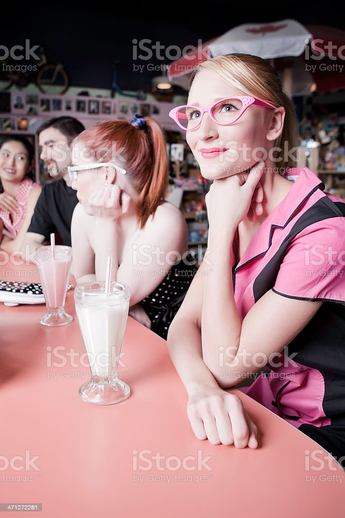 1950's Girl With Friends in Retro Diner stock photo