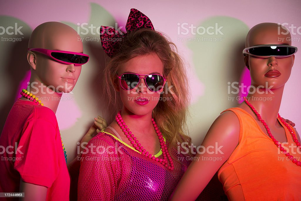 1980's girl with mannequins stock photo