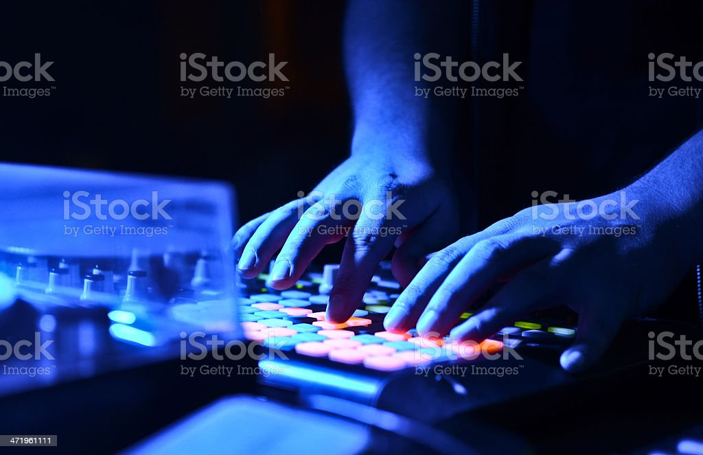 DJ's hand on audio mixer royalty-free stock photo