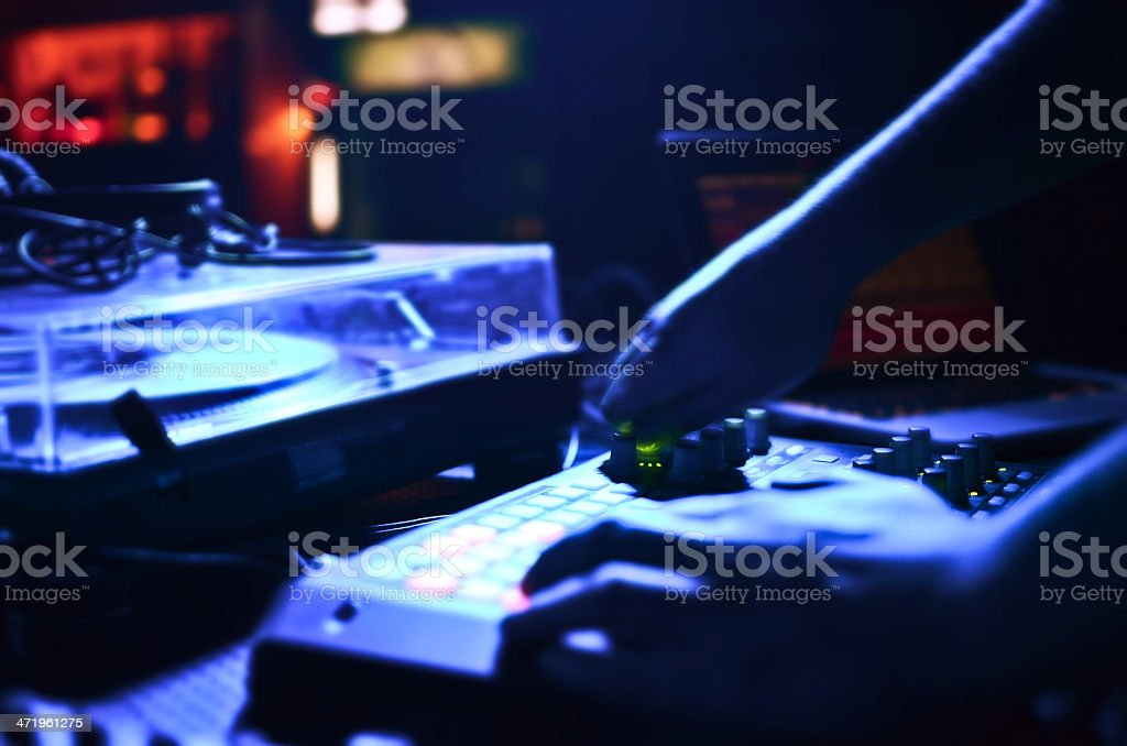 DJ's hands mixing music royalty-free stock photo