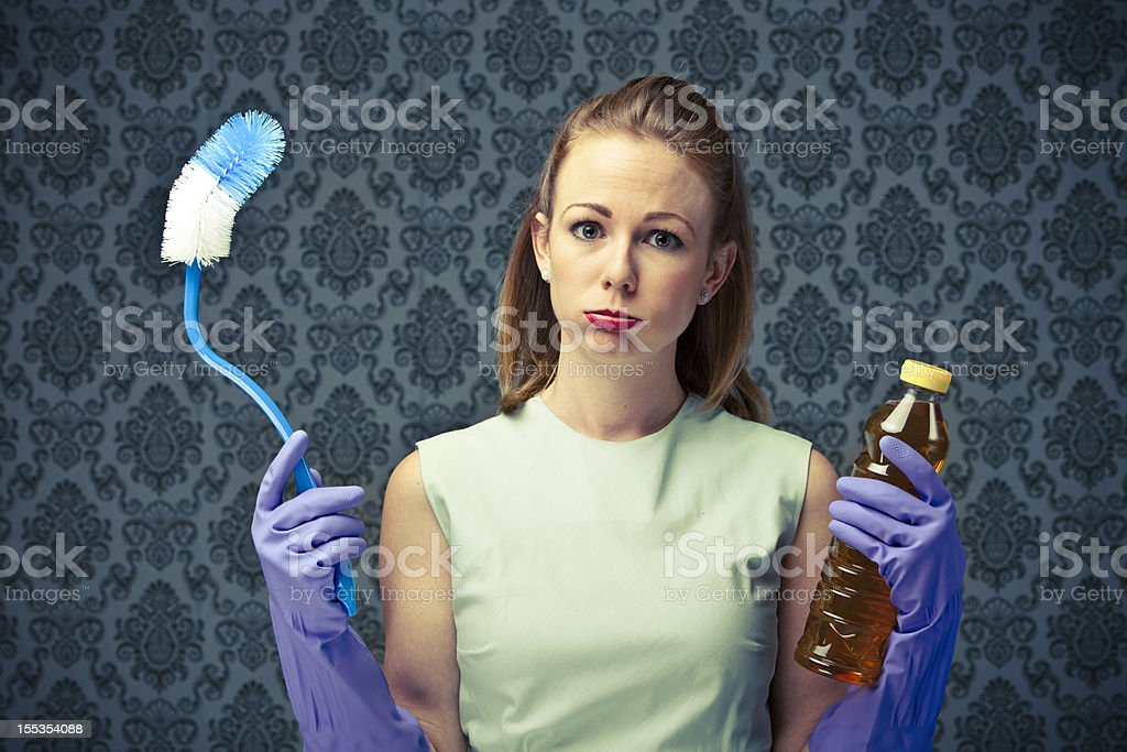 50's Housewife overwhelmed with cleaning stock photo