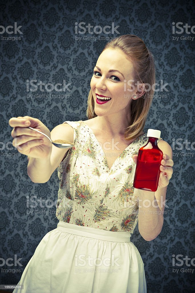 50's Housewife sugar makes the medicine go down royalty-free stock photo