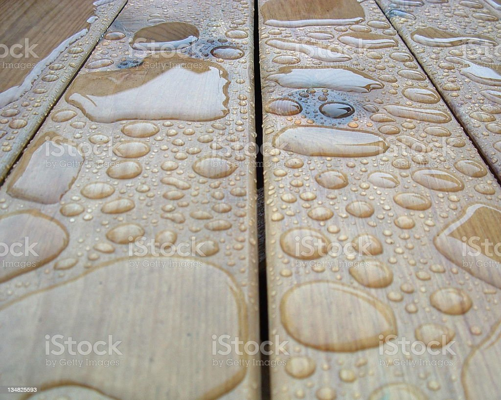 100's of Drops of Rain on Wood royalty-free stock photo