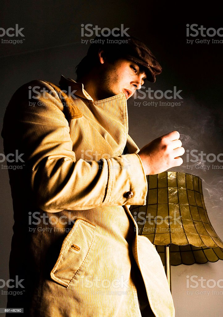 50's style image man smoking in living room royalty-free stock photo