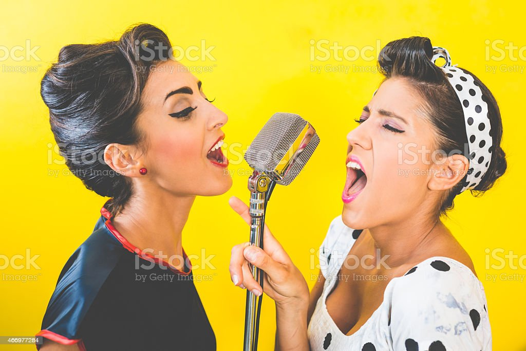 50's Style - Portrait of beautiful singers stock photo