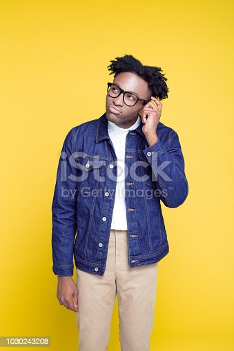 istock 80's style portrait of pensive nerdy young man 1030243208
