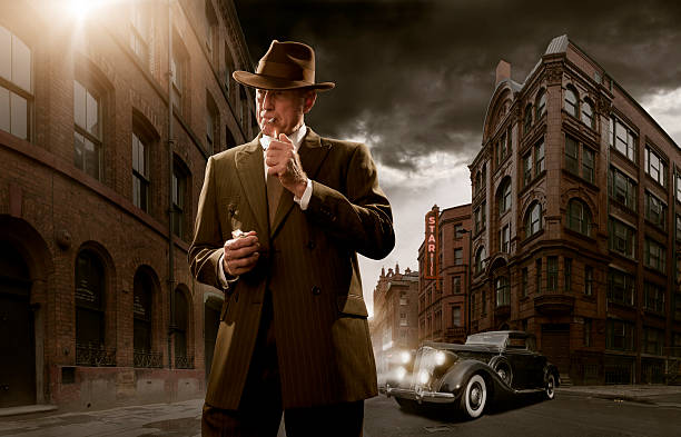 1940's Stylised Film Noir Gangster 1940's stylised film noir gangster / detective in city with car in background gangster stock pictures, royalty-free photos & images