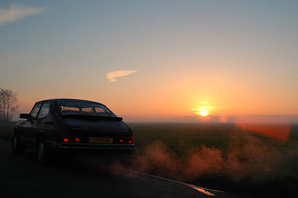 Saab 900 Turbo Kampen, The Netherlands - December 26, 2004: Saab 900 Turbo in a sunset on a cold afternoon in winter. saab stock pictures, royalty-free photos & images