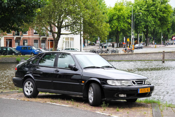 Saab 9-3 Amsterdam, Netherlands - August 10, 2014: Motor car Saab 9-3 in the city street. saab stock pictures, royalty-free photos & images