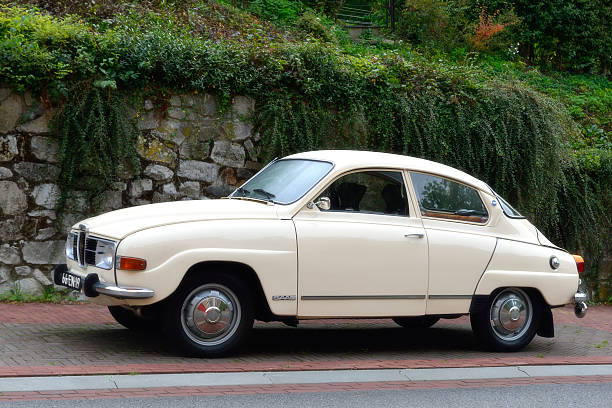 Saab 96 Mheer, The Netherlands - September 21, 2012: Saab 96 classic car parked on the side of a street. The Saab 96 is an automobile made by Saab. It was introduced in 1960 and was produced until January 1980. saab stock pictures, royalty-free photos & images