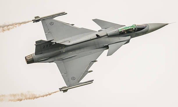 Saab Gripen fighter aircraft, Sweden Fairford, UK - July 9,  2016: a Saab JAS 39 Gripen fighter aircraft of the Swedish Air Force (Flygvapnet) in flight over Gloucestershire, England.  saab stock pictures, royalty-free photos & images
