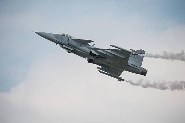 Saab JAS 39 Gripen aircraft Fairford, UK - 12 July, 2014: A Saab JAS 39 Gripen aircraft in flight and displaying at the Royal International Air Tattoo. saab stock pictures, royalty-free photos & images