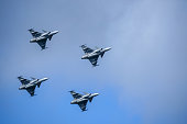 Uppsala, Sweden - August 25, 2018: Saab JAS 39 Gripen, multirole fighter, formation flying. Swedish Air Force, air show.