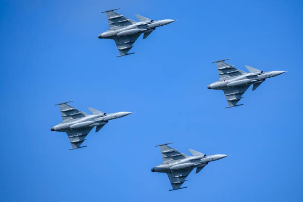 Saab JAS 39 Gripen, multirole fighter, formation flying. Swedish Air Force, air show. Uppsala, Sweden - August 25, 2018: Saab JAS 39 Gripen, multirole fighter, formation flying. Swedish Air Force, air show. saab stock pictures, royalty-free photos & images