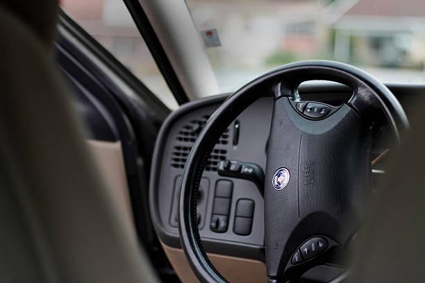 Saab steering wheel Västerås, Sweden - September 7, 2015: Saab steering weel, picture taken in Sweden. Car model is Saab 95 saab stock pictures, royalty-free photos & images