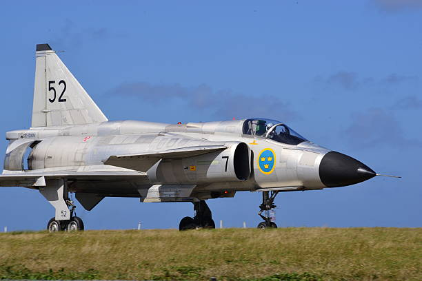 Saab Viggen, Jersey, U.K. Jersey, U.K. - September 8, 2016: The Swedish Air Force Saab Viggen jet fighter taxiing at Jersey Airport for the 2016 airshow. saab stock pictures, royalty-free photos & images