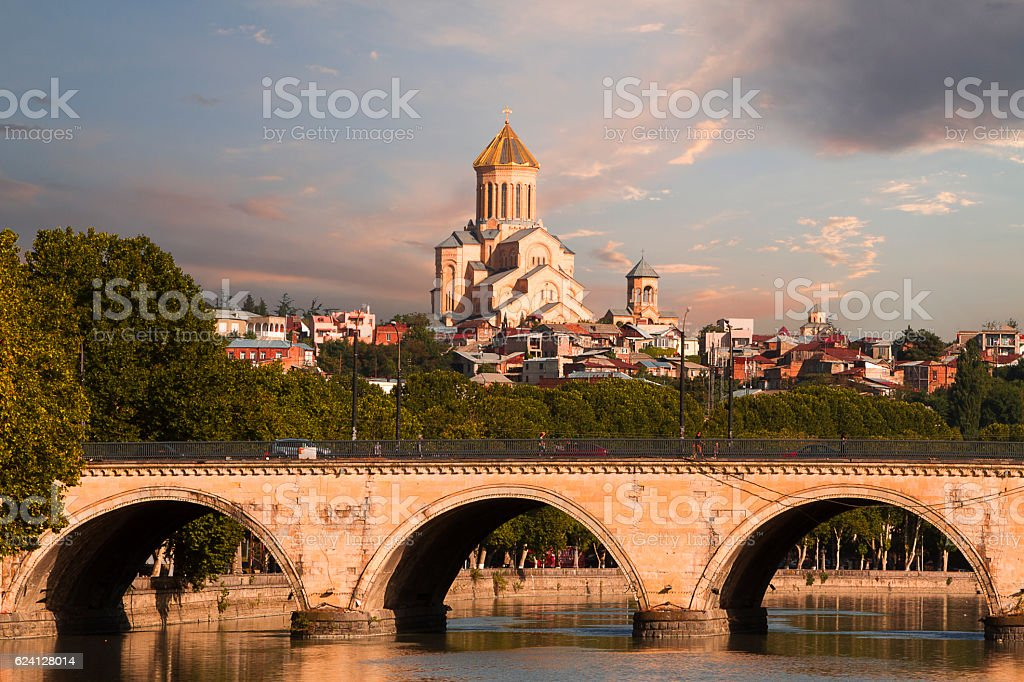 Saarbrucken bridge and Sameba Cathedral in Tbilisi, Georgia stock photo