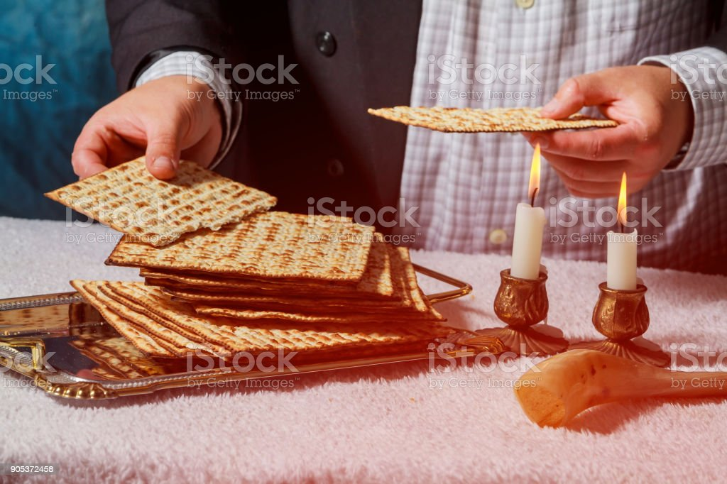 Sabbath kiddush ceremony composition with two candles and traditional passover matzah fresh bread stock photo