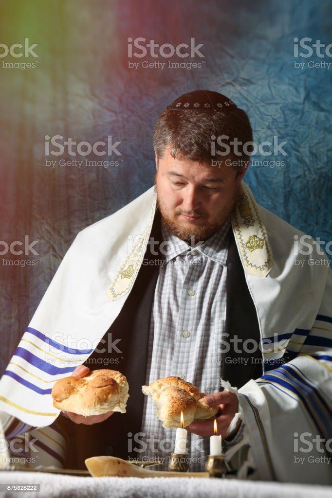 Sabbath kiddush, crystal candlesticks with lit candles, and challah challahs stock photo