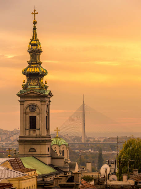 Saborna church in Belgrade at sunset with Belgrade New bridge Saborna church in Belgrade at sunset with Belgrade New bridge, Serbia belgrade serbia stock pictures, royalty-free photos & images