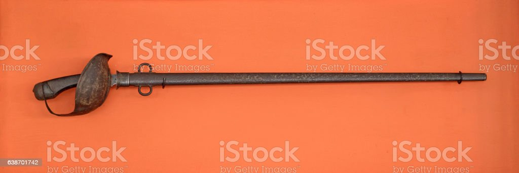Sabre isolated on orange background. stock photo