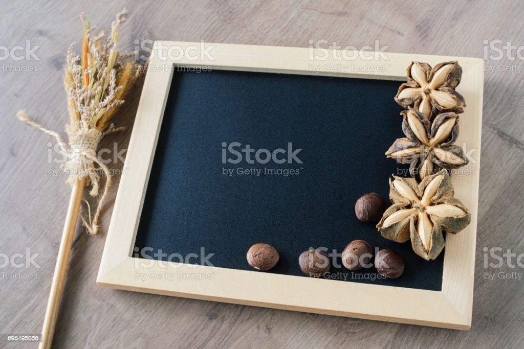 Sacha inchi peanut seed on blackboard background. stock photo
