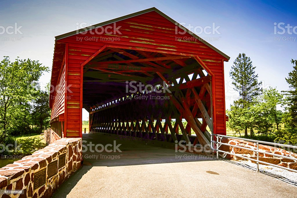 Sachs Covered Red Bridge at Marsh Creek in Pennsylvania stock photo