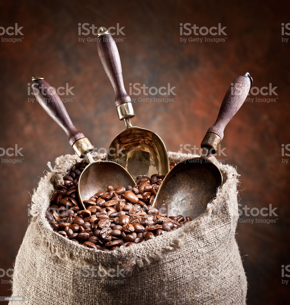 Sack of coffee beans and scoop. stock photo