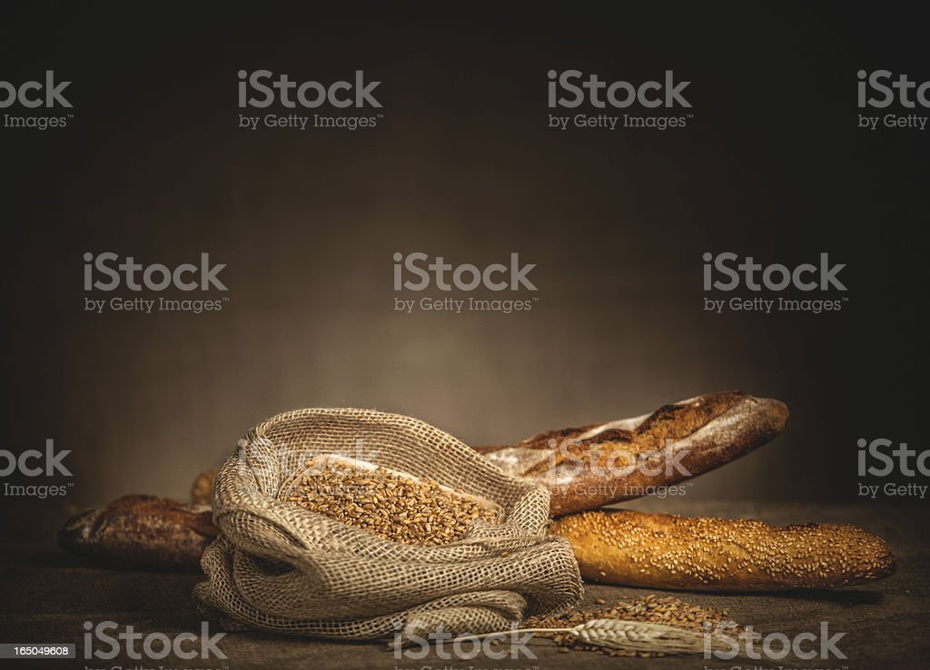 Sack of grain and bread on the background. royalty-free stock photo