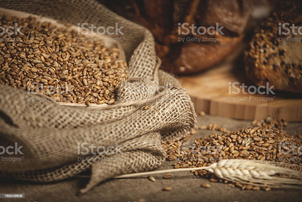 Sack of grain and bread on the background. stock photo