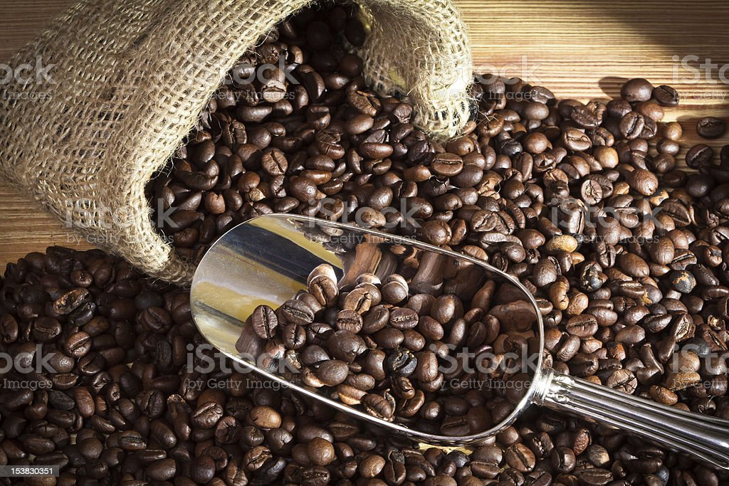 Sack with coffee beans on old plank stock photo