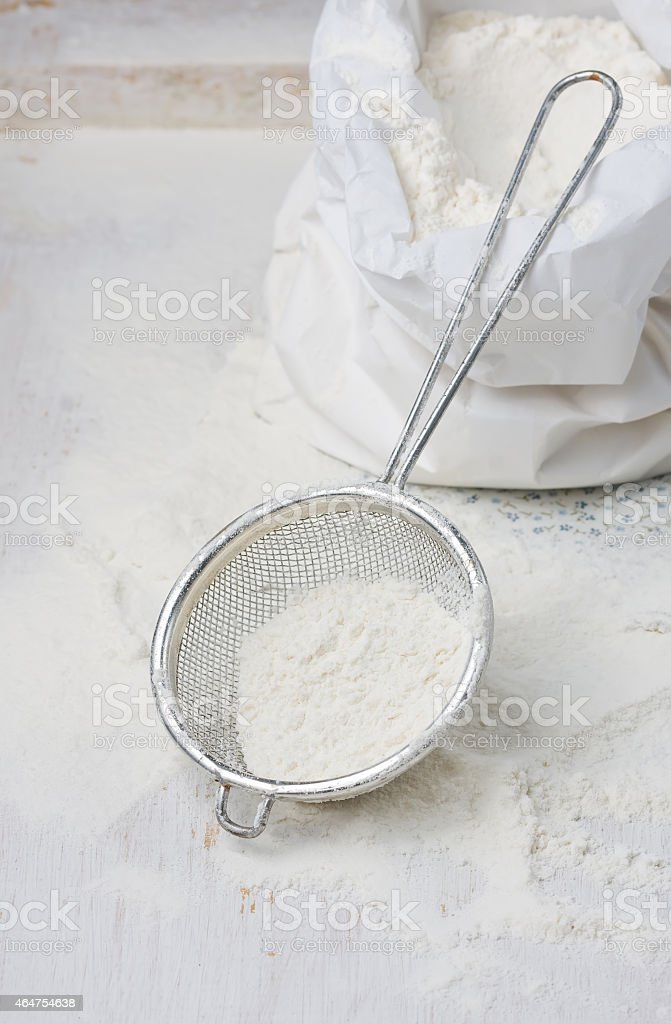 Sack with flour and sieve stock photo