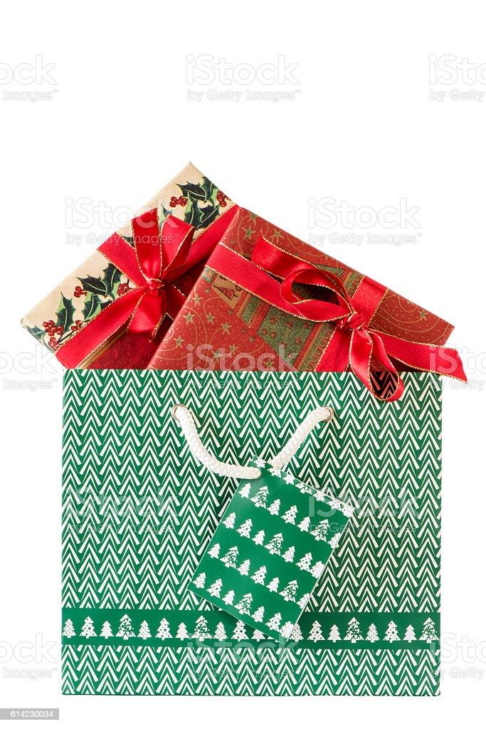 Sackerl mit zwei Weihnachtsgeschenken stock photo