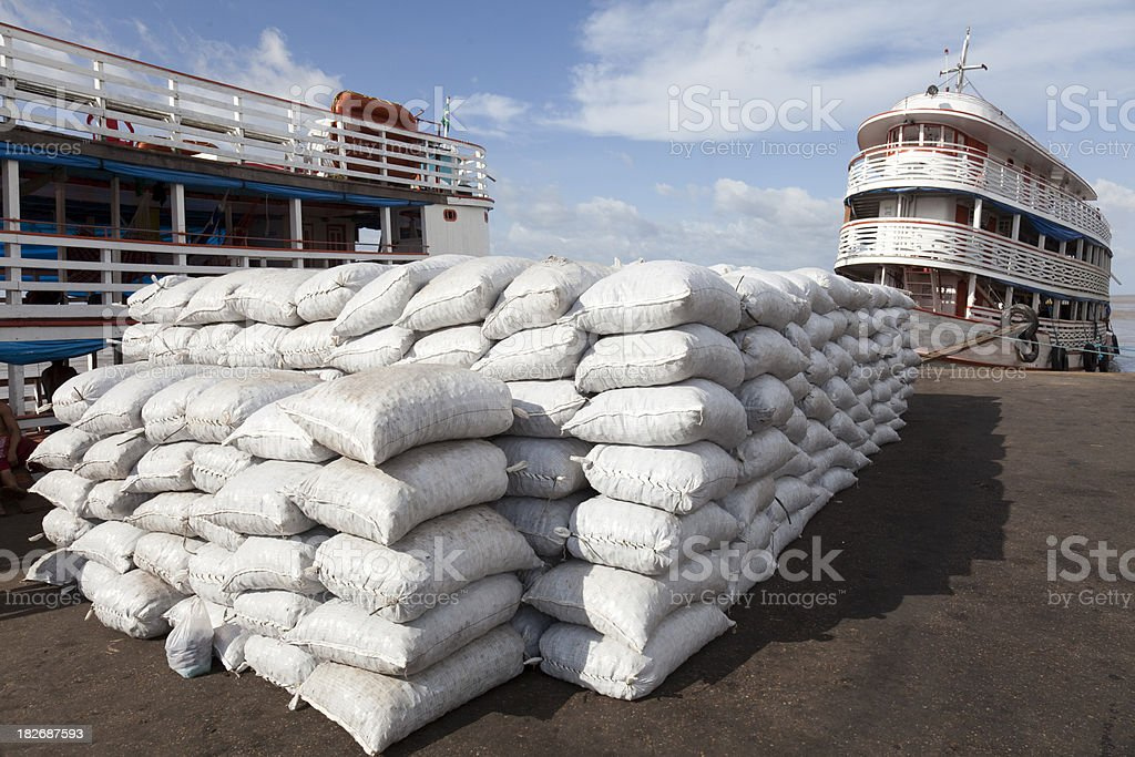 Sacks at a dock in Manaus royalty-free stock photo