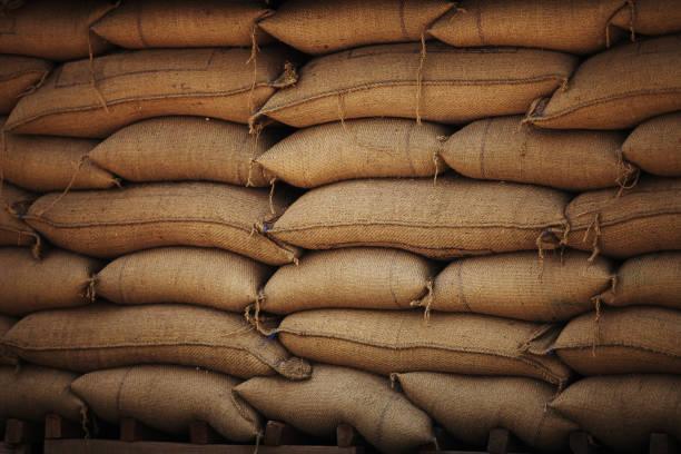 Sacks full of grains in burlap bags stock photo